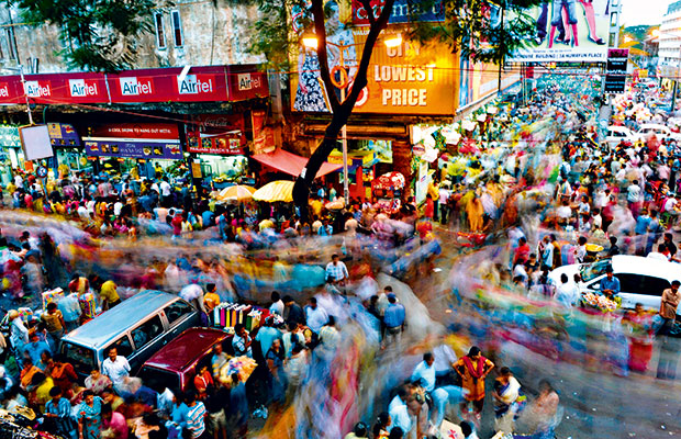 Indian shoppers are seen at a busy shopping area ahead of the Durga Puja festival in Kolkata