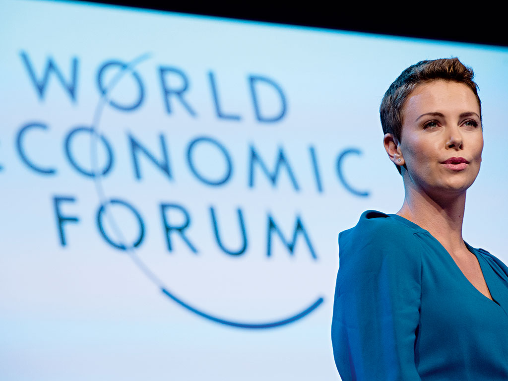 Charlize Theron accepted an award at the WEF's 2013 Annual Meeting for her humanitarian work