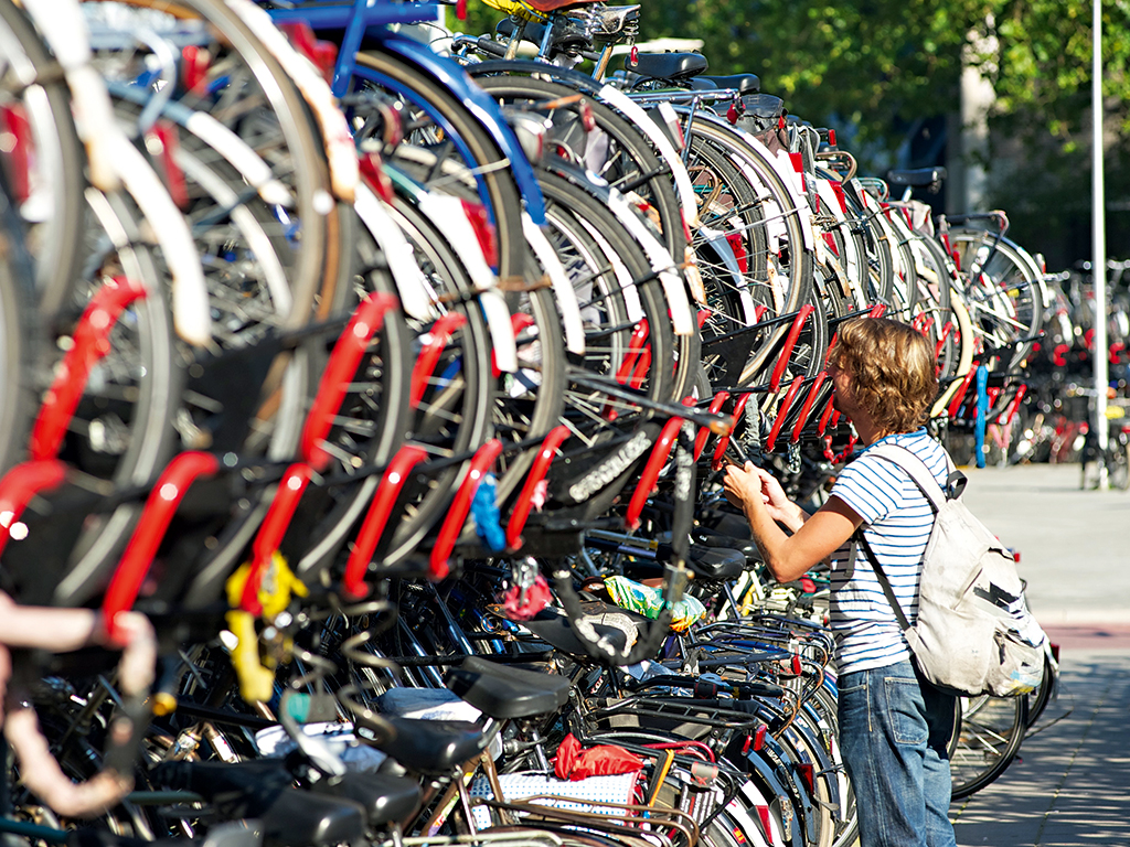 A bicycle rack near Utrecht's central station. The city is committed to sustainability and lowering emissions © Kjell Postema