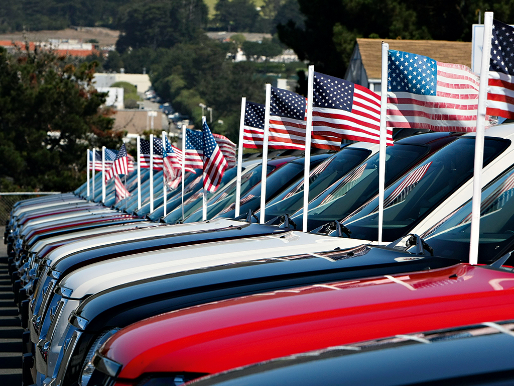 Brand new, patriotic Ford pickup trucks in Colma, California. Auto dealers are large donors to US political campaigns