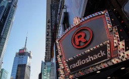 Online retail giant in talks to buy some RadioShack stores, giving the firm its first physical presence on the high street