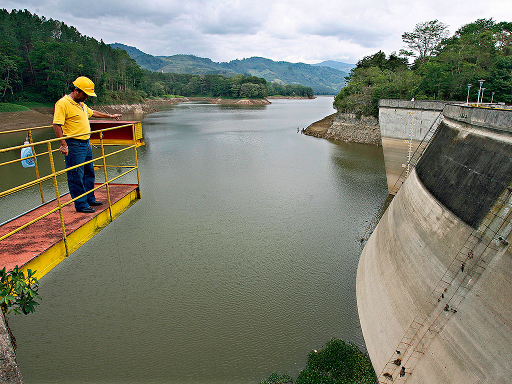 An ICE operator looks at the water level at the Cachi dam in Costa Rica
