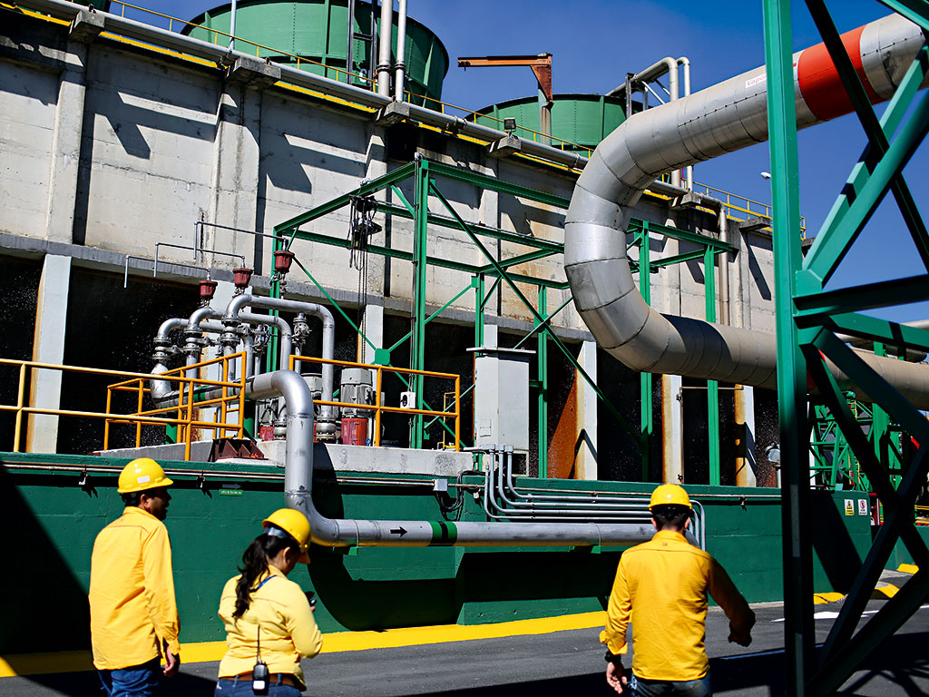 Workers at a geothermal power plant run by the Costa Rican Institute of Electricity