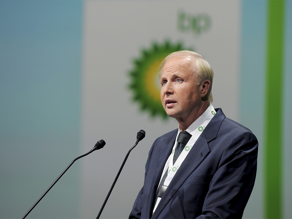 Second-quarter profits at oil giant BP have almost halved in a year, following a plummet in global oil prices and weak refining margins