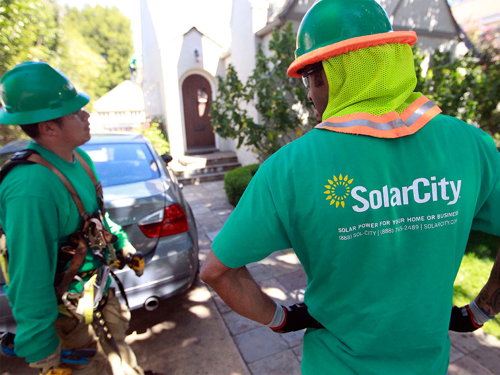 Tesla is set to complete its takeover of SolarCity, with the firm's founders taking significant pay cuts to make up for job losses and salary reductions throughout the company